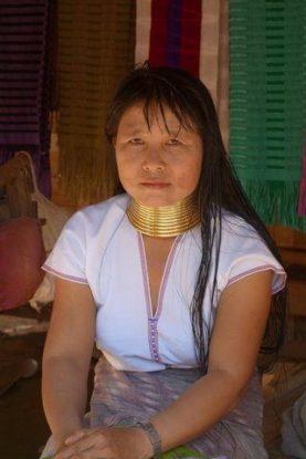 Women with long necks besides Karen village